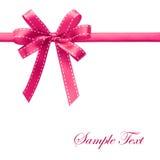 Bande rose brillante de satin sur le fond blanc Images stock