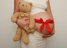 bande rouge enceinte de ventre Image libre de droits