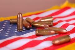 Bandeira americana com balas Fotografia de Stock Royalty Free