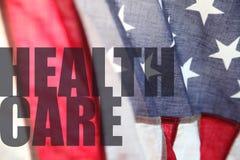 Bandeira americana com palavras dos cuidados médicos Imagens de Stock