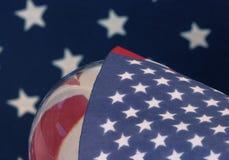 A bandeira americana dos EUA global protagoniza como uma tampa Fotografia de Stock