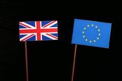 Bandeira britânica com a bandeira da UE da União Europeia no preto Foto de Stock
