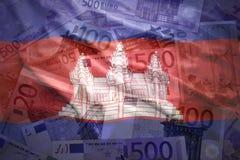 Bandeira cambojana de ondulação colorida em um euro- fundo Fotos de Stock Royalty Free