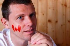 Bandeira canadense na cara do homem novo Imagem de Stock Royalty Free