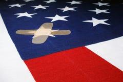 Bandeira com Bandaid Imagem de Stock Royalty Free