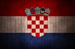 Bandeira croata com o sinal em um fundo de madeira ilustração stock