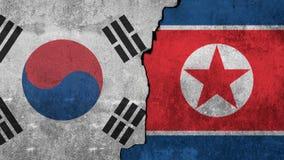 Bandeira da Coreia do Norte e de Coreia do Sul em um fundo da parede fotografia de stock