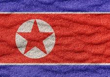 Bandeira da Coreia do Norte na areia ilustração do vetor