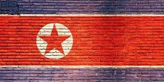 Bandeira da Coreia do Norte pintada em uma parede de tijolo ilustração 3D Fotografia de Stock