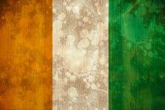 Bandeira da Costa do Marfim no efeito do grunge ilustração royalty free