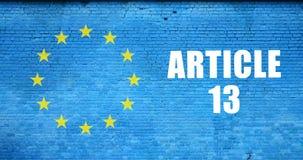 Bandeira da inscri??o do artigo 13 e da Uni?o Europeia na parede de tijolo azul imagens de stock royalty free