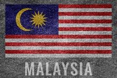 Bandeira da nação de MALÁSIA no projeto da textura de brim imagem de stock