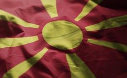 A bandeira da República da Macedônia emaranhou próximo acima fotografia de stock royalty free