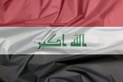 Bandeira da tela de Iraque Vinco do fundo iraquiano da bandeira imagem de stock royalty free