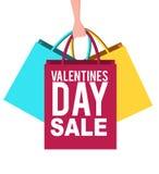 Bandeira da venda do dia de Valentim com sacos de compras Imagem de Stock