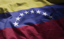 A bandeira da Venezuela emaranhou perto acima fotos de stock