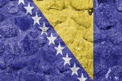 Bandeira de Bósnia e de Herzegovina em uma parede de pedra ilustração stock