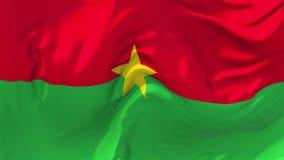 Bandeira de Burkina Faso que acena no fundo sem emenda contínuo do laço do vento