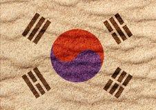 Bandeira de Coreia do Sul na areia ilustração do vetor