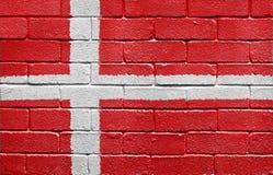 Bandeira de Dinamarca na parede de tijolo Fotos de Stock Royalty Free