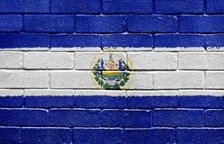 Bandeira de El Salvador na parede de tijolo Foto de Stock Royalty Free