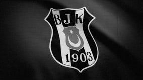 A bandeira de FC Besiktas é acenar, monocromática, ruído da tevê Close-up da bandeira de ondulação com logotipo do clube do futeb ilustração stock