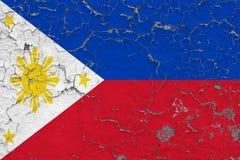 A bandeira de Filipinas pintou em parede suja rachada Teste padr?o nacional na superf?cie do estilo do vintage ilustração stock