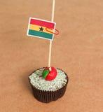 Bandeira de Gana em um queque da maçã Foto de Stock Royalty Free