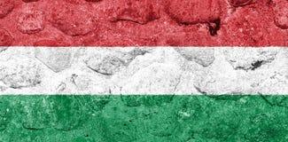 Bandeira de Hungria em uma parede de pedra ilustração royalty free