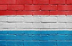 Bandeira de Luxembourg na parede de tijolo Foto de Stock