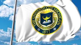 Bandeira de ondulação com emblema da Universidade do Michigan grampo do editorial 4K ilustração stock