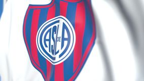 Bandeira de ondulação com logotipo do clube do futebol de San Lorenzo de Almagro, close-up Animação 3D loopable editorial ilustração royalty free