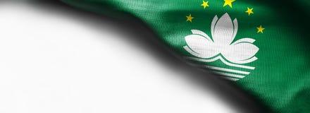 Bandeira de ondulação da tela de Macau no fundo branco fotografia de stock royalty free