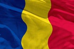 A bandeira de ondulação de Romênia para usar-se como a textura ou o fundo, a bandeira está vibrando no vento fotografia de stock