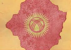 Bandeira de Quirguizistão no furo rachado concreto grande e em material quebrado Fotos de Stock