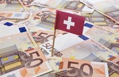 Bandeira de Suíça que cola em euro- notas Imagem de Stock