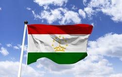 Bandeira de Tajiquistão, centro um emblema dourado imagens de stock