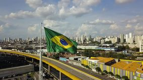 Brazil flag fluttering in strong wind shot with drone