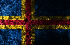 Bandeira do fundo do grunge de Aland, bandeira dependente do território de Finlandia foto de stock royalty free