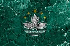 Bandeira do grunge de Macau, bandeira dependente do território fotografia de stock royalty free