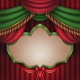 Bandeira do Natal sobre o fundo vermelho e verde da cortina da fase do teatro Fotos de Stock