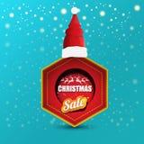 Bandeira do papel das vendas do Natal do vetor ou etiqueta da etiqueta com o chapéu vermelho de Santa no fundo nevado dos azuis c ilustração do vetor