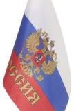 Bandeira do russo com o emblema de Rússia fotografia de stock royalty free