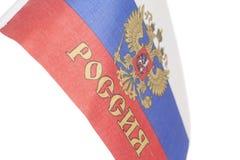 Bandeira do russo com o emblema de Rússia fotos de stock royalty free