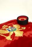 Bandeira e tampão montenegrinos Imagens de Stock
