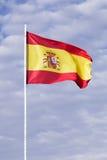 Bandeira espanhola que acena no vento Fotografia de Stock Royalty Free