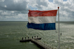Bandeira holandesa de ondulação Fotografia de Stock