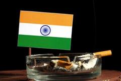 Bandeira indiana com o cigarro ardente no cinzeiro no preto Foto de Stock Royalty Free