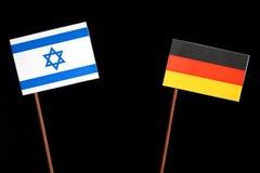 Bandeira israelita com a bandeira alemão no preto Imagem de Stock Royalty Free