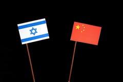 Bandeira israelita com a bandeira chinesa no preto Imagem de Stock Royalty Free